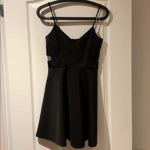 Black mini dress with mesh cutouts.